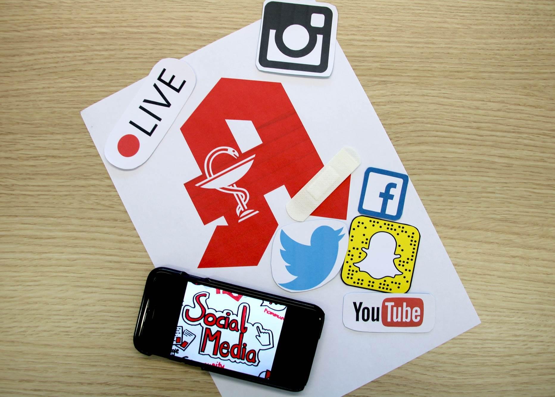 Social Media Symbole und Apothekenzeichen